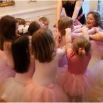 ballerina party guests in pink tutus.