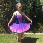 beautiful ballerina in a purple dress